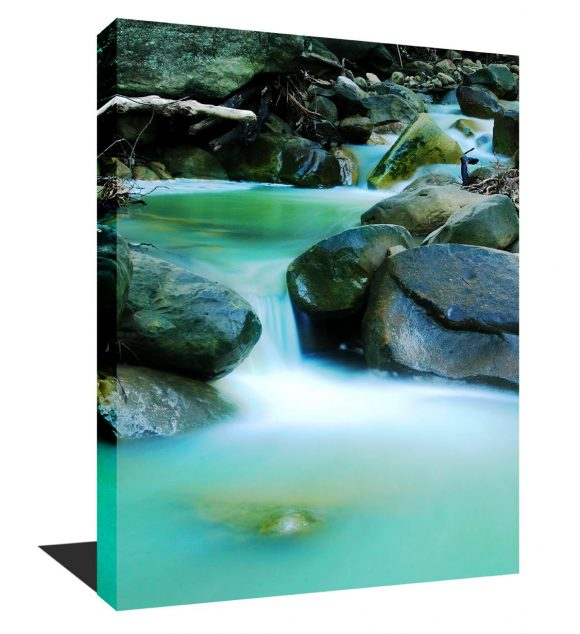 A stunning photo museum quality canvas gallery wrap of a teal green creek.